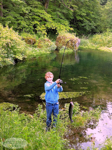 boy on trout stream